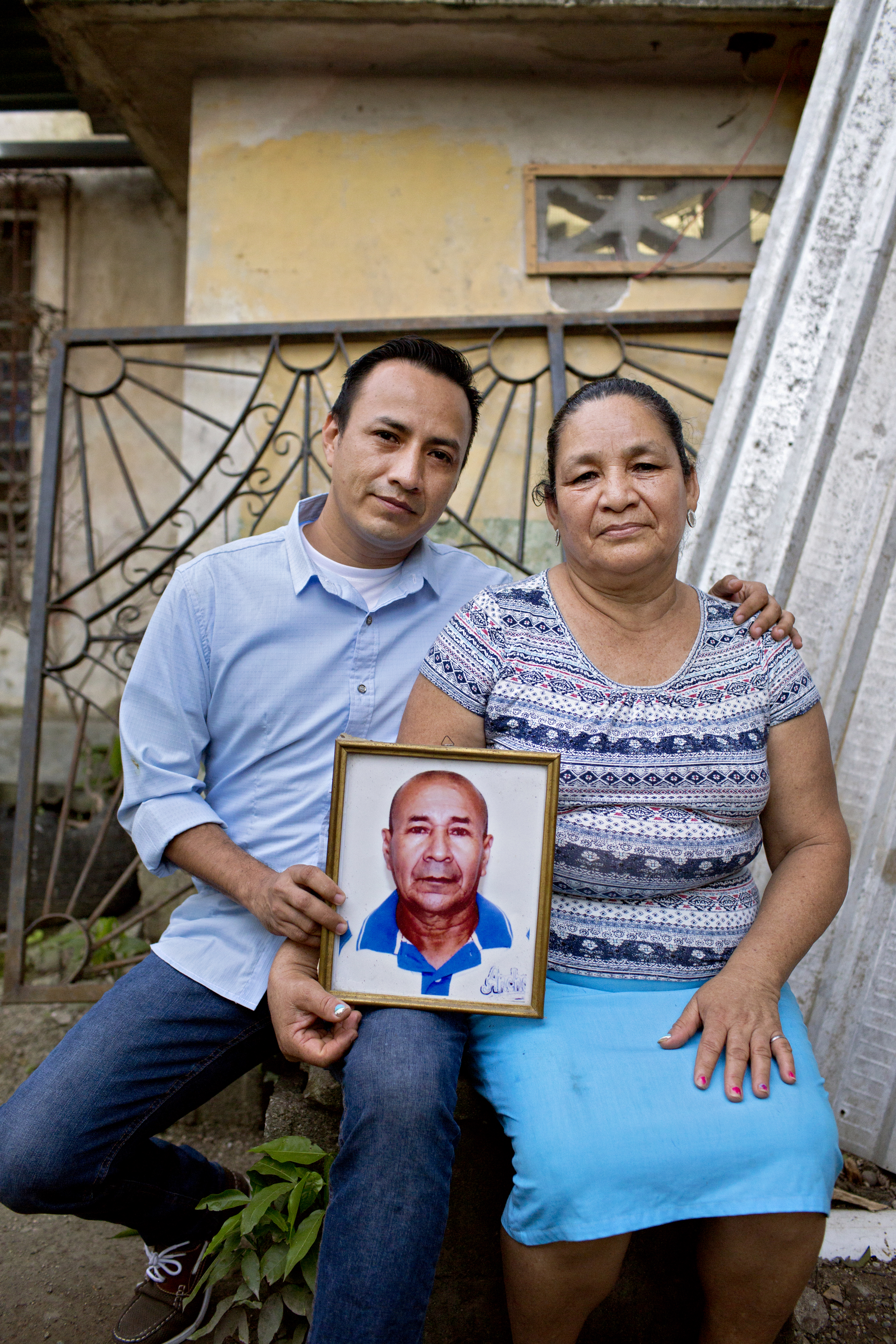 Ángel Lenin Flores and his mother hold a photo of José Ángel, a campesino leader murdered by a paramilitary band that has cropped up in a battle for land between campesino cooperatives and wealthy landowners in the Bajo Aguán region of Honduras