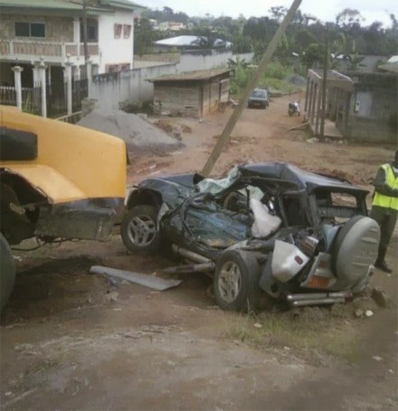 Koum Koum's vehicle and the timber truck that crushed it